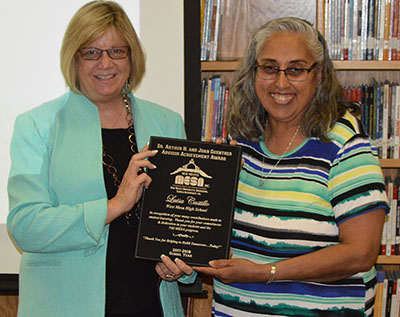 Tracie O'Geary, member of the NM MESA Board of Directors, presents the Guenther Award to Luisa Castillo